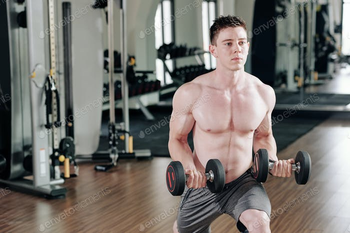 Man doing lunges with heavy weights