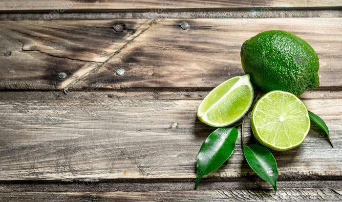 Pieces of juicy lime with leaves.