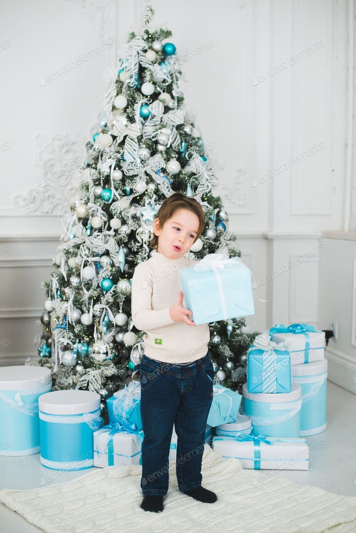 holidays, presents, christmas, x-mas concept - happy child boy with gift box