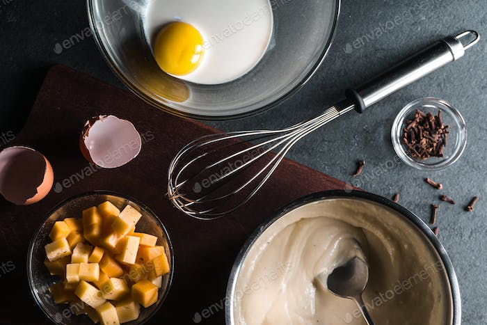 Egg, cream, base sauce and whisk, spices for cooking mornay