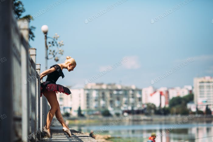 ballerina posing on a background of the lake