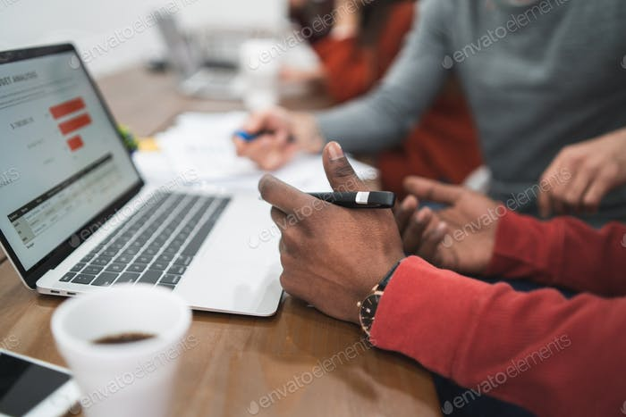 business person working on laptop and cheking information.