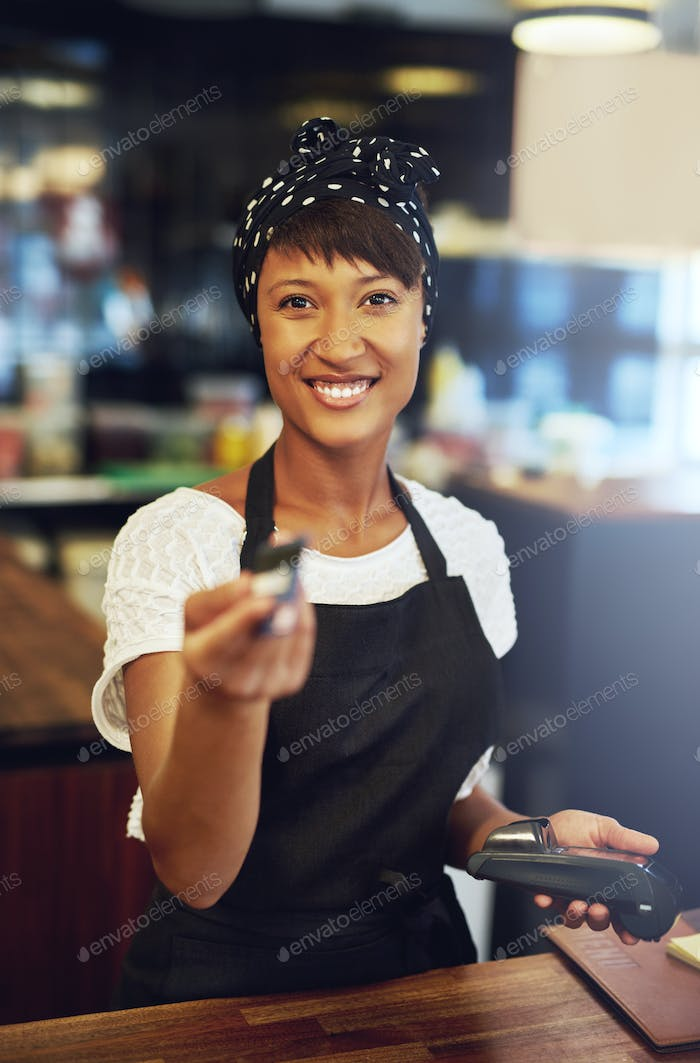 Attractive business owner returning a credit card