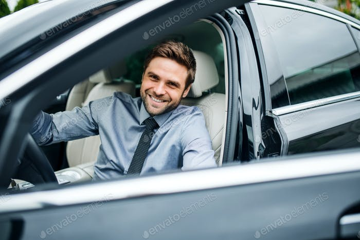 Young man with blue shirt and tie getting out of car in town.