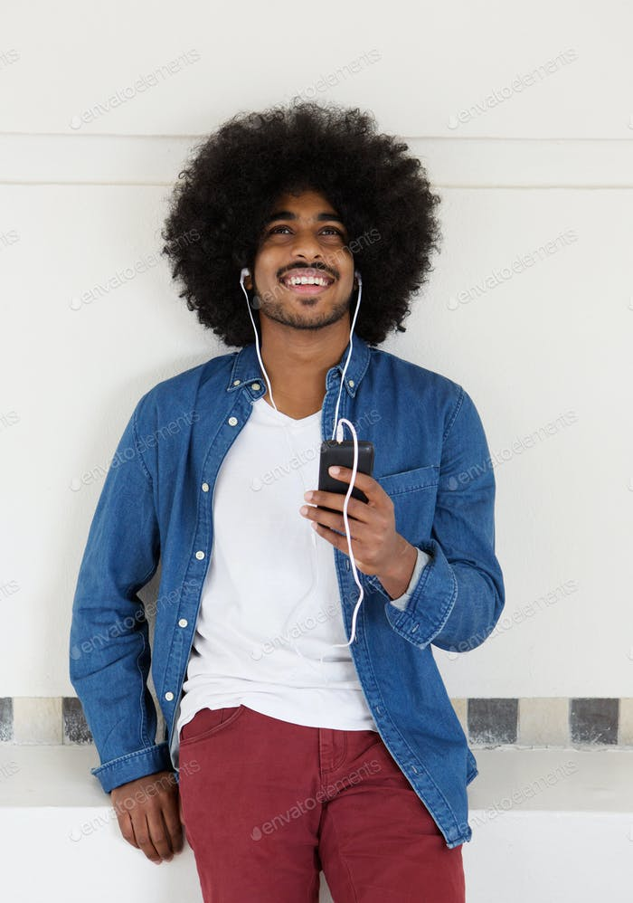 Happy man listening to music on cellphone