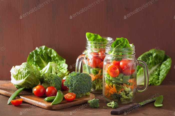 healthy vegetable salad in mason jar. tomato, broccoli, carrot,