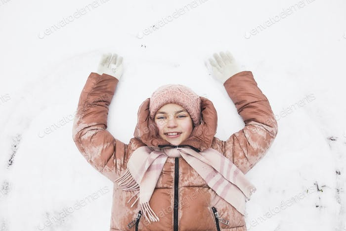 Cute Girl Making Snow Angels