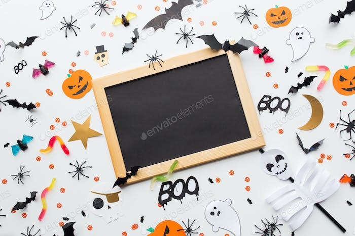 blank chalkboard and halloween party decorations