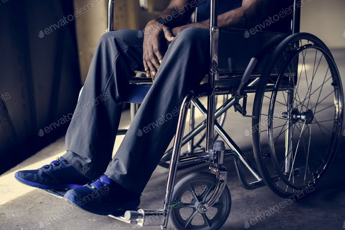 Disabled african man sitting on the wheelchair