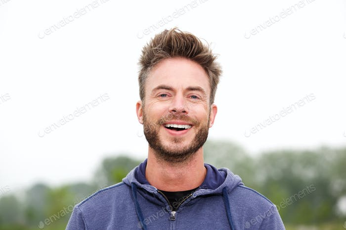 Smiling middle age athletic man
