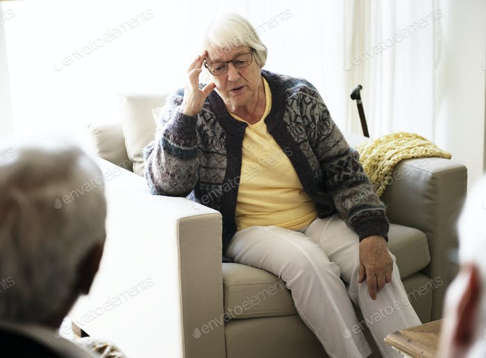Senior woman sitting on a sofa