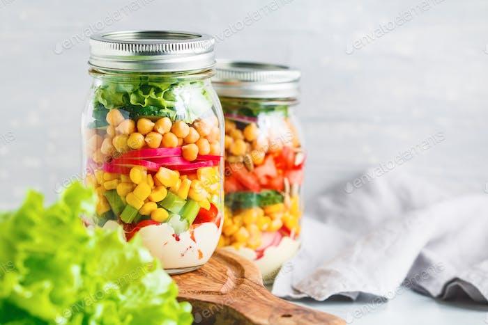 Glass jars with salad