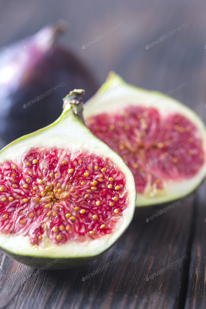 Fresh figs on the wooden background