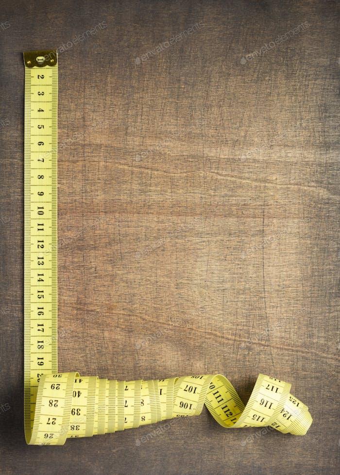 tape measure on slate stone background