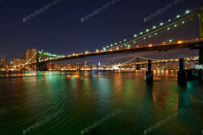 Brooklyn Bridge with lower Manhattan skyline at night