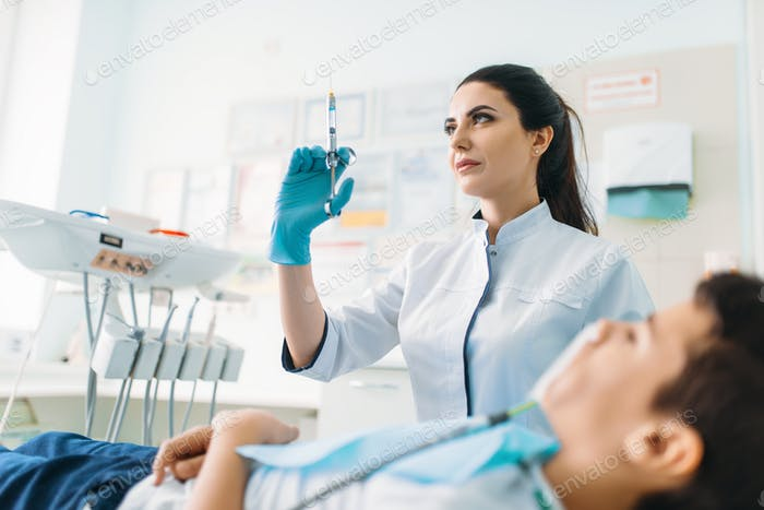 Female dentist with syringe, pediatric dentistry