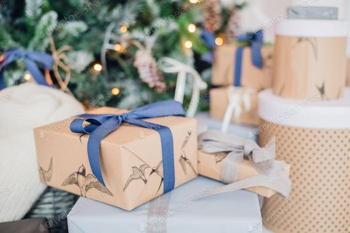 Christmas gift or present box wrapped in kraft paper