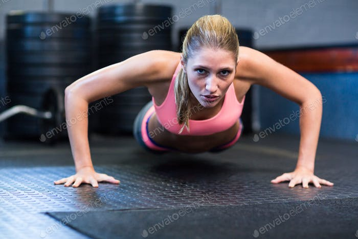 Determined woman doing push-ups