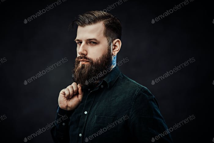 Young stylish hipster guy posing in studio