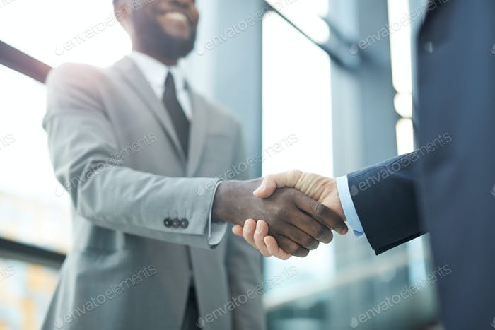 Unrecognizable Businessmen Shaking Hands