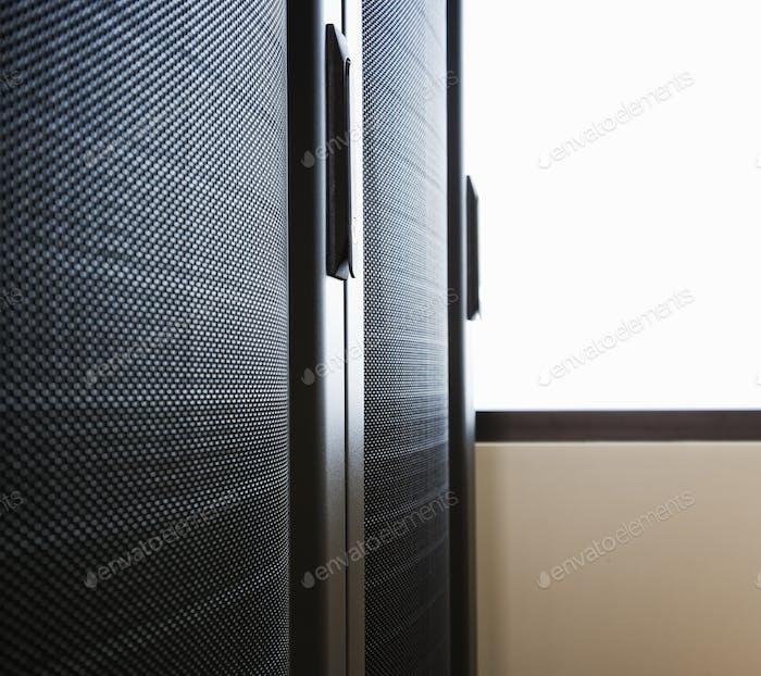 Rack housing servers in computer server farm