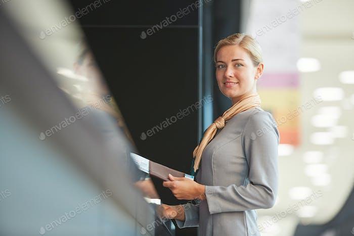 Female Flight Attendant at Check In Desk