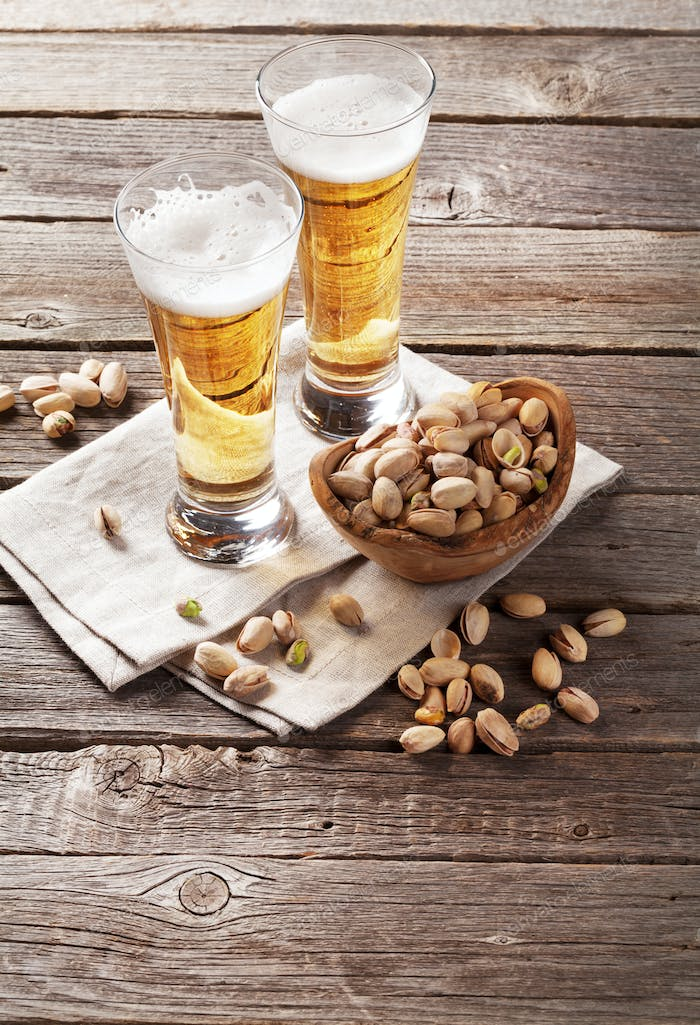 Lager beer glasses and snacks