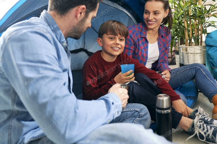 Family spending time together while camping indoors