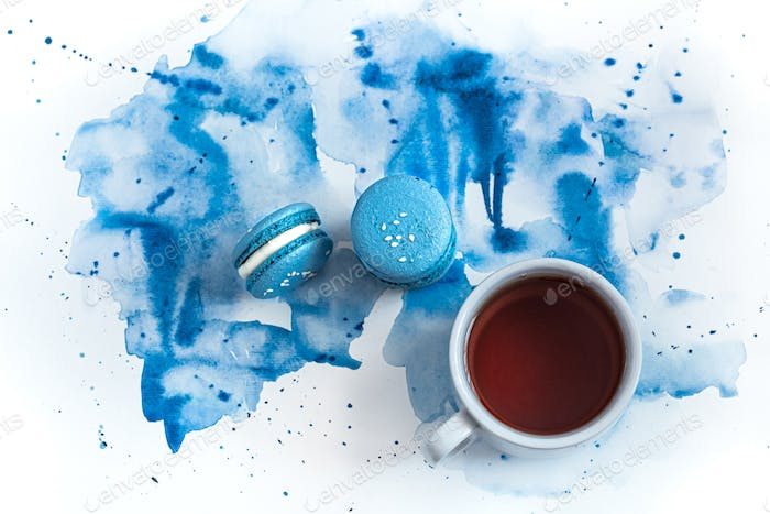 Dessert macaroon on a blue watercolor background.