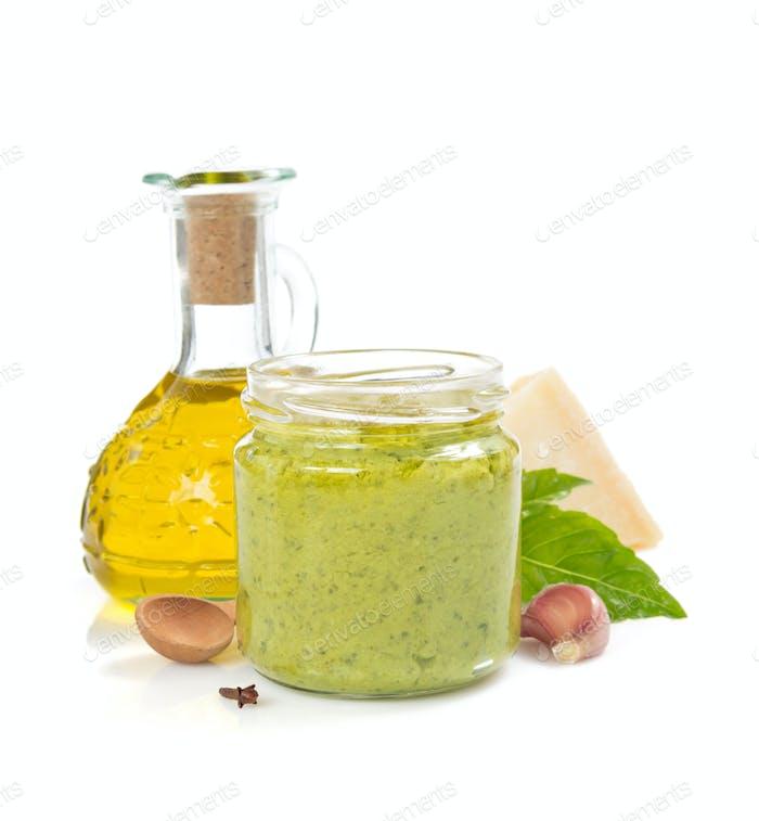 pesto sauce in jar on white background