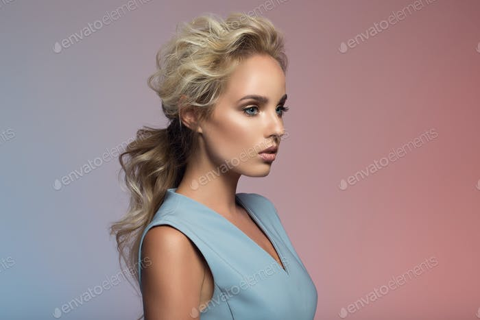 Fashion Portrait Of Beautiful Woman. Colorful Background.
