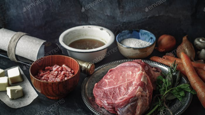 Ingredients for Boeuf Bourguignon on the  dark stone  table horizontal