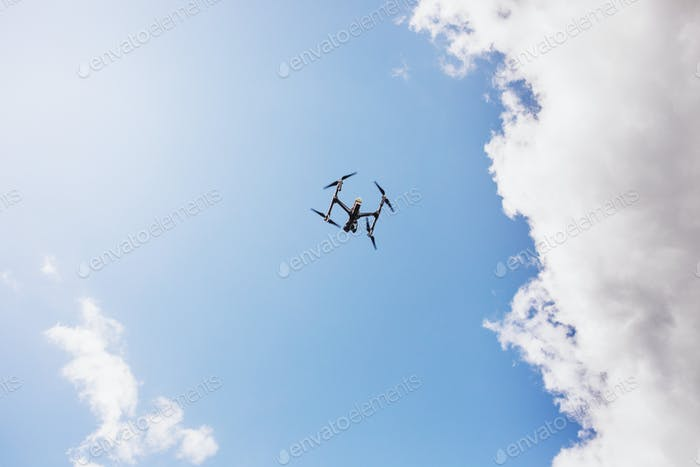 Low angle view of drone flying