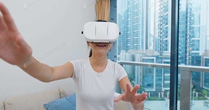 Woman play VR at home