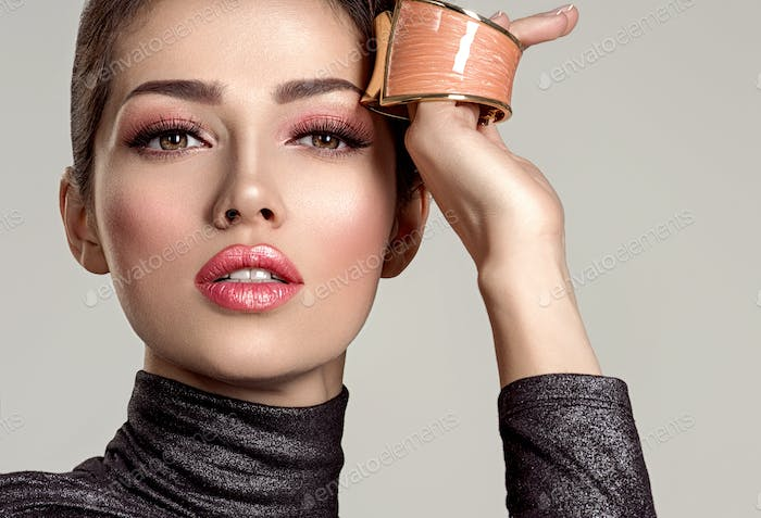 Beautiful  fashion woman with living coral lipstick. Attractive