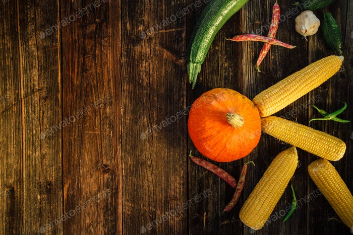 High angle view of fresh vegetables on wooden background