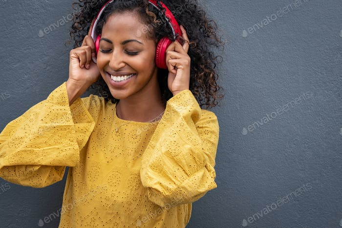 Beautiful african woman listening to music