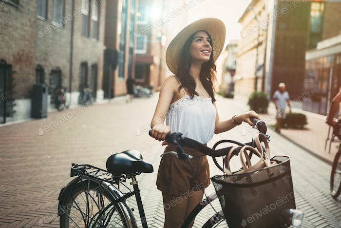 Tourist woman using bicycle
