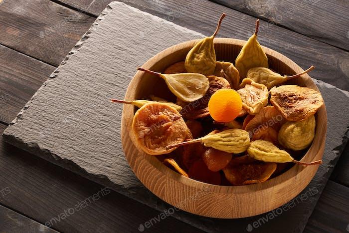 Dried fruits on slate plate