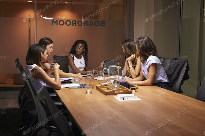 Businesswomen in discussion at an evening meeting