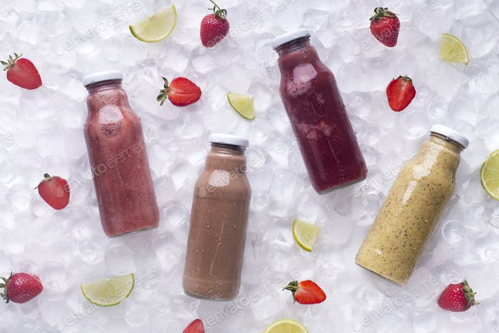 Refreshing detox smoothie drinks with fresh strawberries on ice