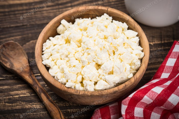 Curd or cottage cheese at wooden table