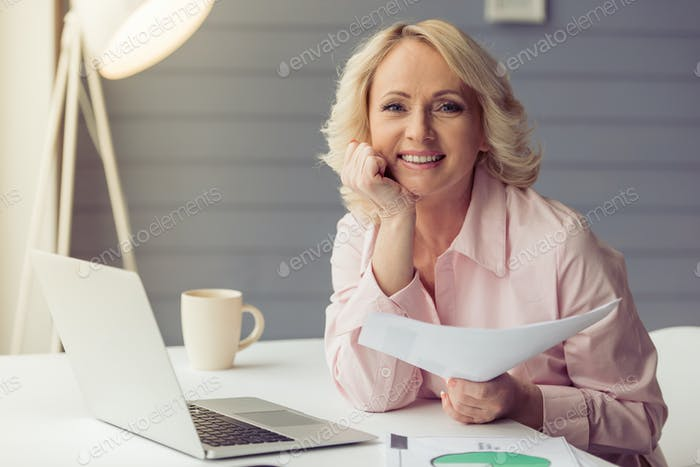 Beautiful old woman working