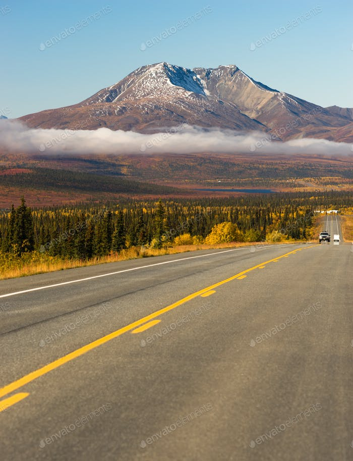 Highway Leads On Wilderness Road Alaska Mountain Landscape