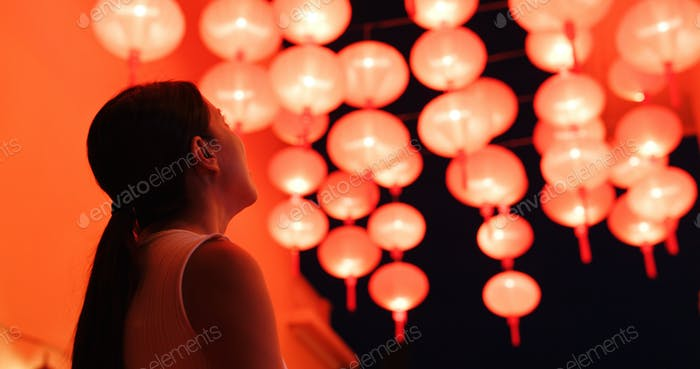 Woman look at the red lantern for mid autumn festival