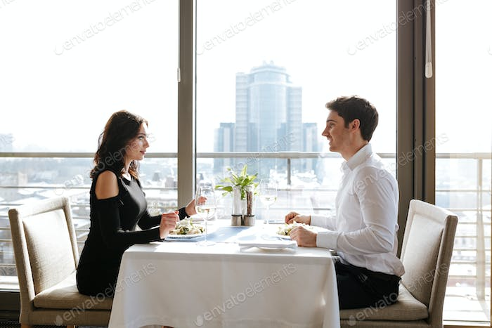 Loving couple sitting in restaurant indoors