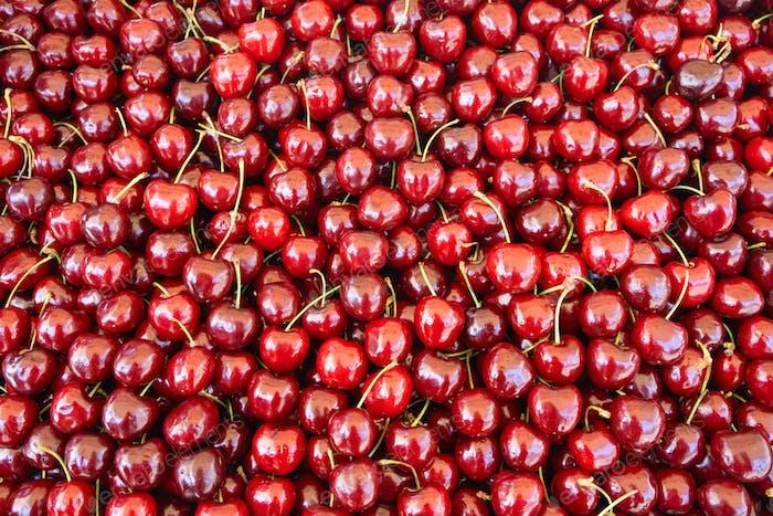 Las cerezas se apilan en el mercado de los agricultores, fondo, textura