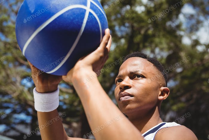 Close up of teenage boy practicing basketball