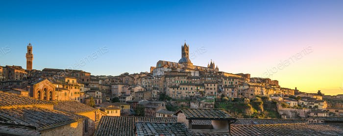 Siena sunset panoramic skyline. Mangia tower and cathedral duomo