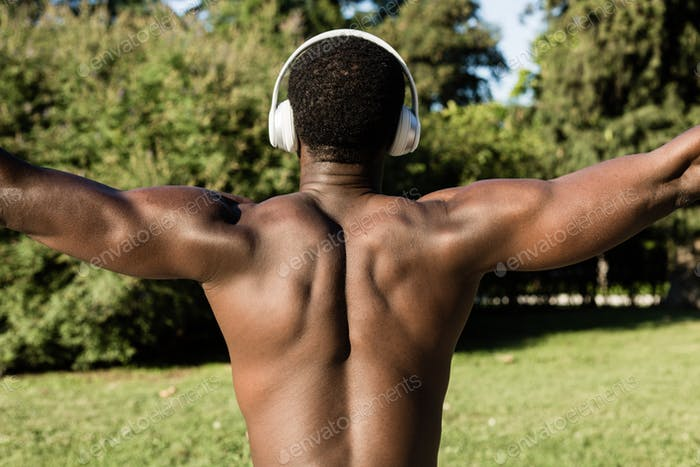 Athletic black man listening to music